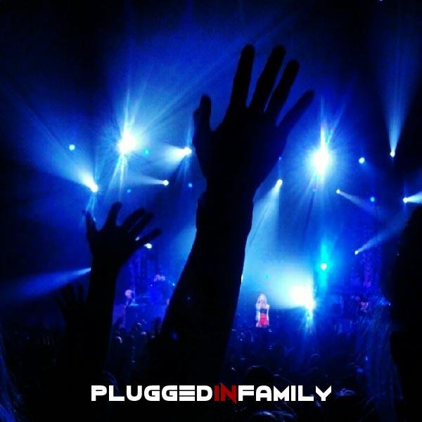 Hand raised in air Demi Lovato on stage Phoenix Arizona tour