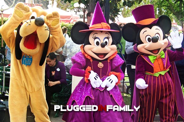 Pluto with Mickey and Minnie dressed in Halloween costumes