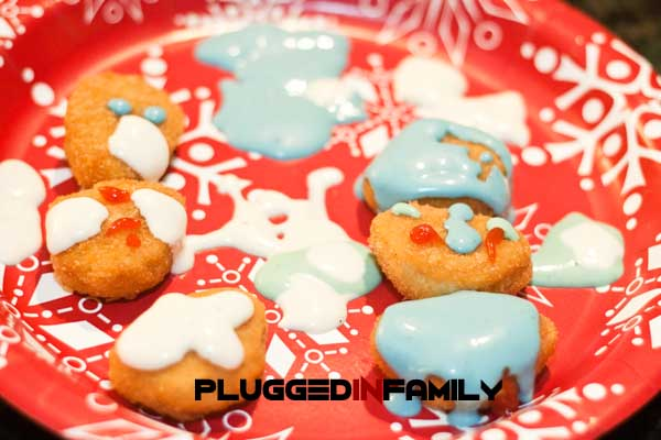 Child decorated chicken nuggets with colored ranch
