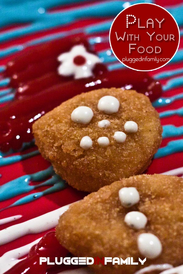 Decorating snowman chicken nuggets is fun with Ranch dressing