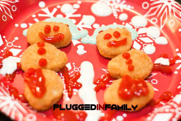 Snowman chicken nuggets decorated by a child