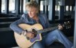 Rod Stuart playing his guitar for his new album