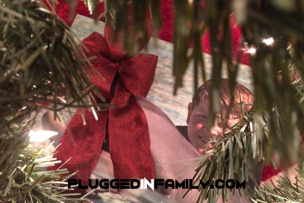 Print photos from iPhone under Christmas tree ©2013 Plugged In Family ©2013 Wright Media LLC