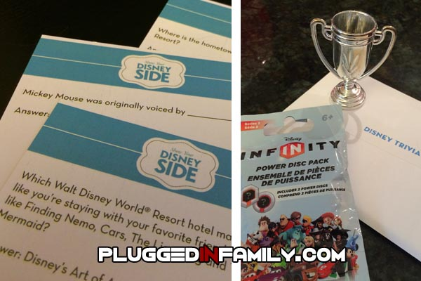 Disney trivia cards where winner takes trophy and Disney Infinity power discs