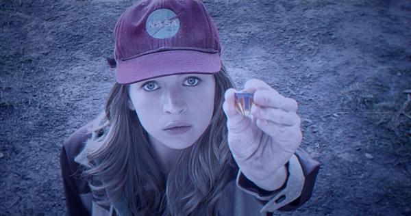 Holding Tomorrowland pin