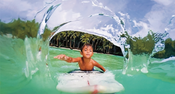 Boy surfing captured by GoPro camera