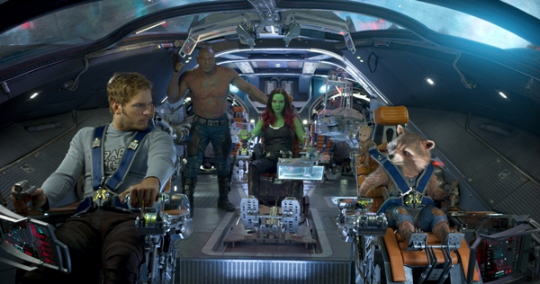 Star-Lord, Gamora, Drax, Rocket, and Baby Groot driving the Milano