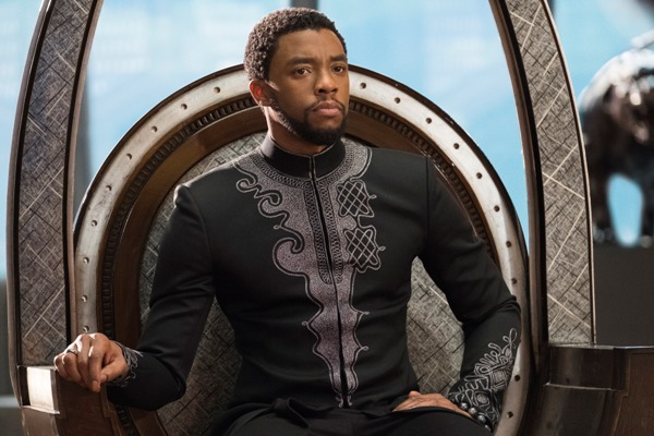 T'Challa sitting on his throne played by Chadwick Boseman
