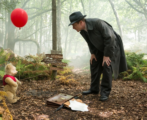 Christopher Robin and Winnie the Pooh with red balloon