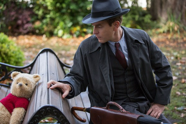 Grown up Christopher Robin bumps into Winnie the Pooh