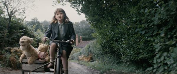 Madeline Robin riding bike daughter of Christopher Robin