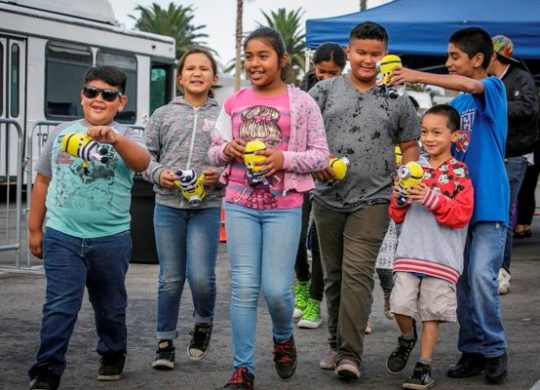 Day of Giving at USH 2018 Children holding stuffed minions