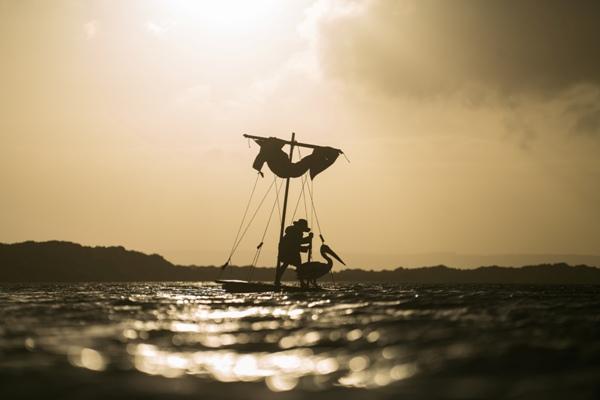 Boy with pelican on boat in Australia ocean in Storm Boy